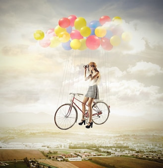 Girl on a bike with balloons