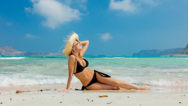 Girl in black bikini and with hat on balos beach