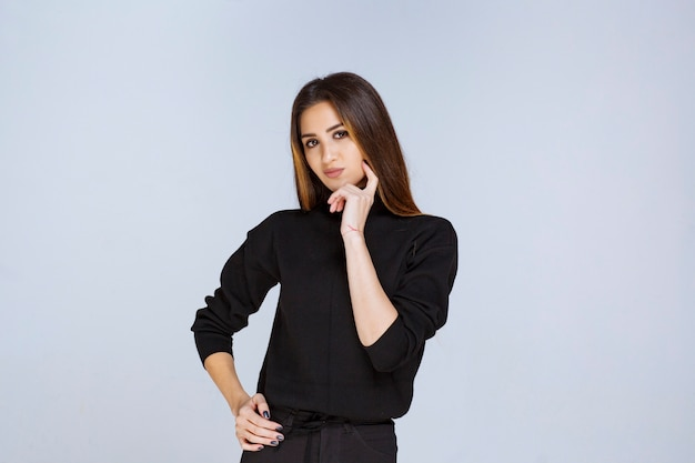 Girl in black shirt thinking and analizing. high quality photo