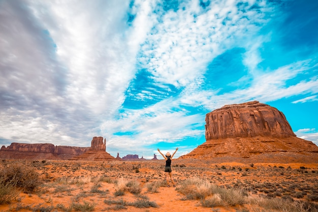 A girl in a black t-shirt in the monument valley national park in three sisters.