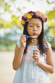 Girl blowing bubble wand