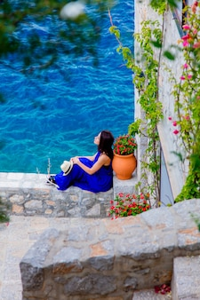 Girl in blue dress in city of hydra island