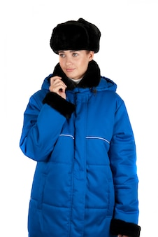 Girl at blue quilted coat on a white