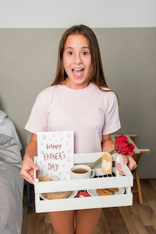 Girl brings breakfast on fathers day