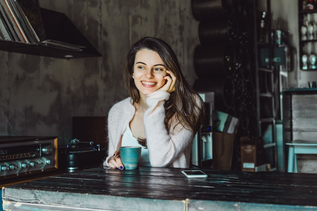 Girl in a cafe with a smartphone