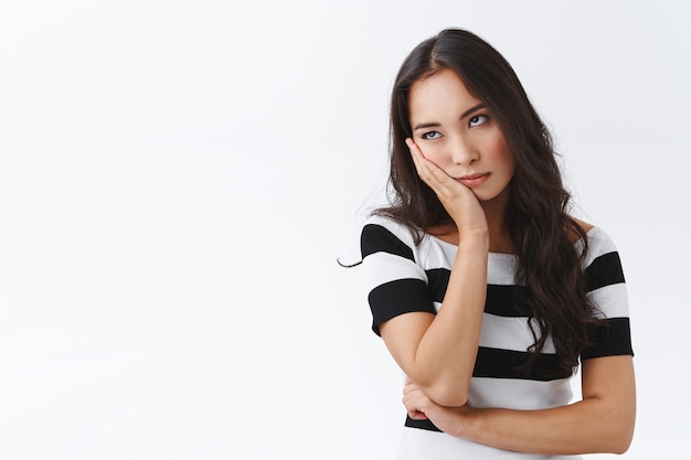 Girl cant stand long talks, wanna escape from boring meeting. annoyed and bored fed up asian female, facepalm and roll eyes bothered, standing uninterested and dissatisfied over white background