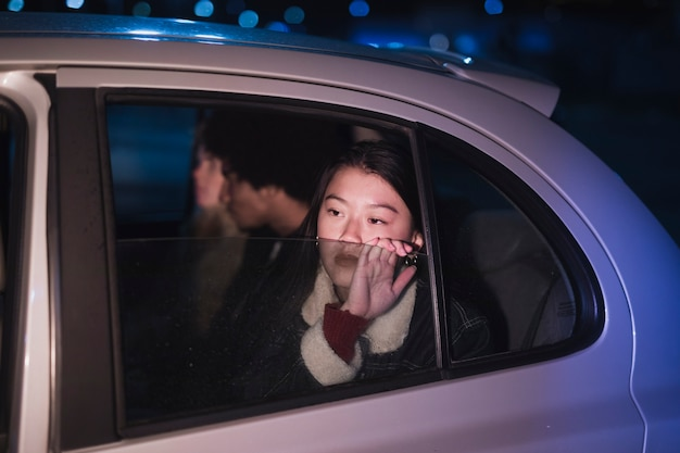Girl in car at night