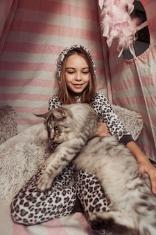 Girl and cat indoors