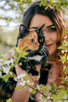 Girl and cat. spring or summer warm weather concept. bokeh background.