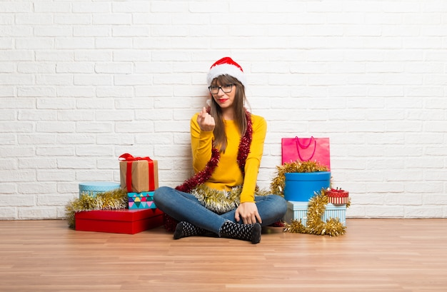 Girl celebrating the christmas holidays presenting and inviting to come