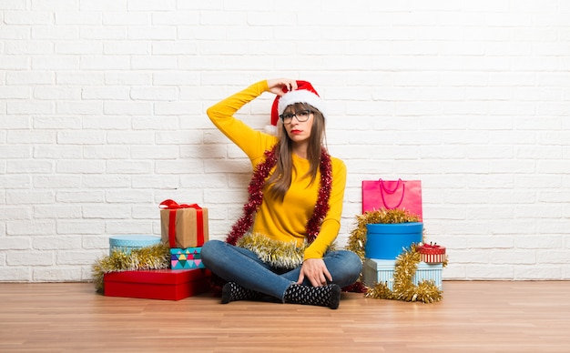 Girl celebrating the christmas holidays standing and thinking an idea