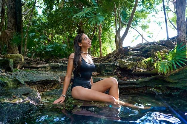 Girl in cenote at riviera maya of mexico