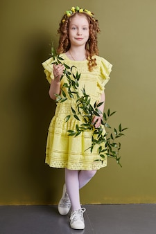Girl child in bright spring clothes. romantic look and smile on your face