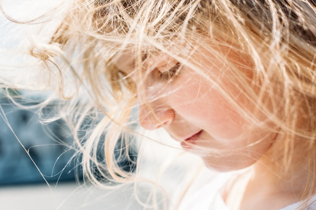 Girl, child dancing on the roof, wind and hair, sun glasses, joy, childhood