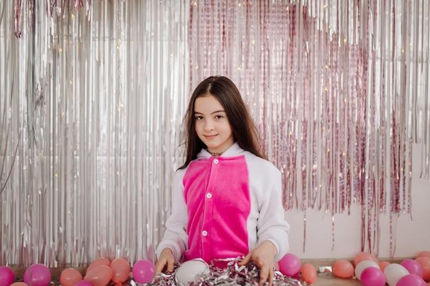 Girl child having fun and posing in studio