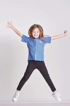 Girl child having fun and posing in studio