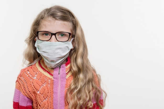 Girl child in medical mask