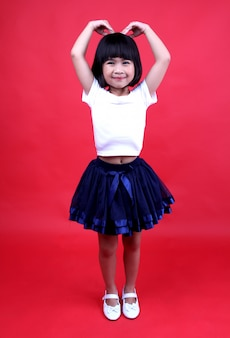 Girl child smiling happily in the studio.