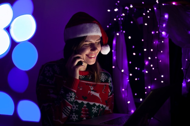 Girl in christmas clothes talking on the phone
