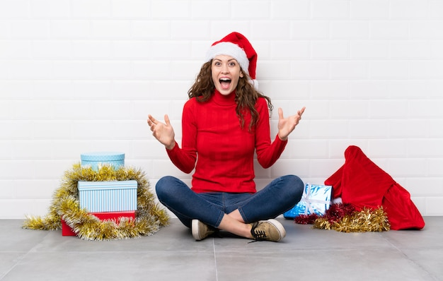 Girl in christmas holidays sitting on the floor unhappy and frustrated with something