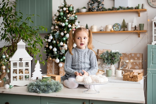 Girl in christmas morning kitchen at home.