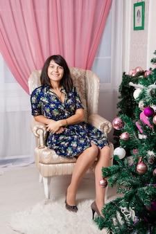 Girl on christmas tree.