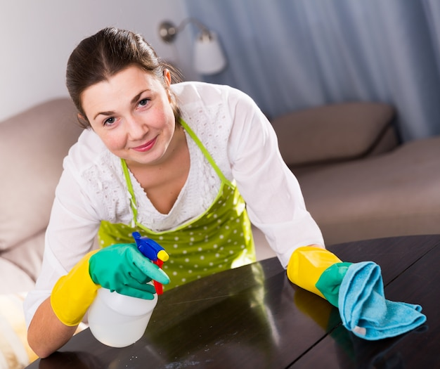 Girl clean table at home