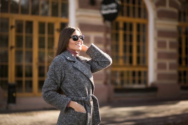 Girl in coat standing in the street