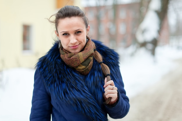 Girl in coat at wintry street