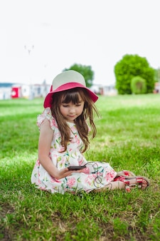 Girl content with a mobile phone in her hand