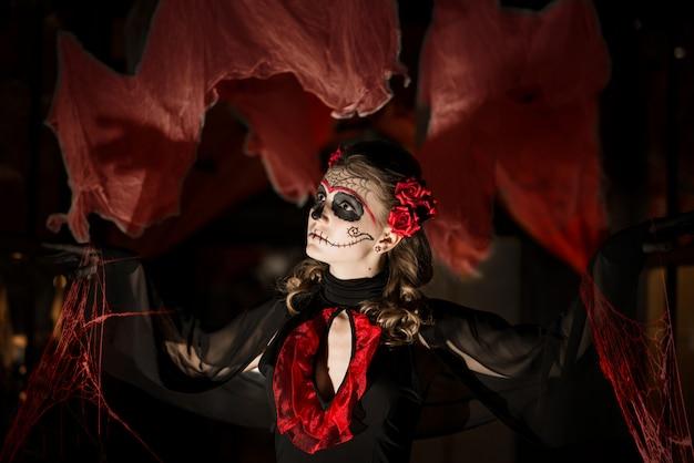 Girl in costume for halloween.