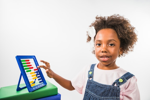 Girl counting on abacus in studio