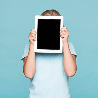 Girl covering face with frame