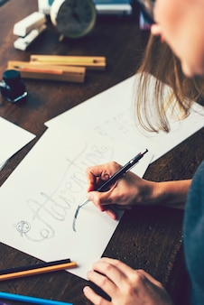 Girl creating a typography illustration