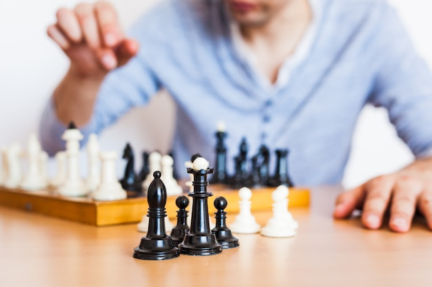 Girl and dad play a game at home, chess, puzzle for brain development, mental intelligence