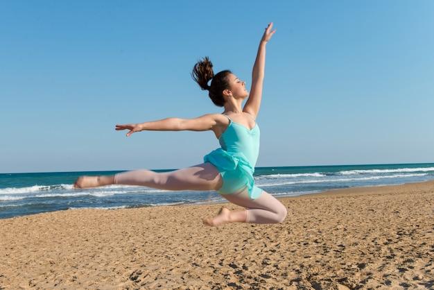 Girl dancing in the beach