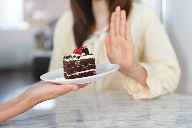 Girl deny to eat sweet or cake during diet