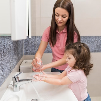 Girl disinfecting hands medium shot
