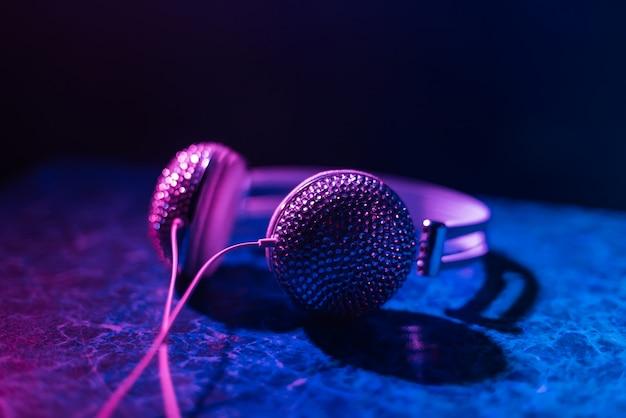 Girl dj headphones decorated with rhinestones in nightclub