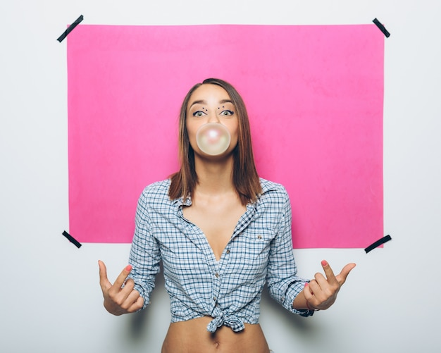 Girl doing a bubble with a chewing gum