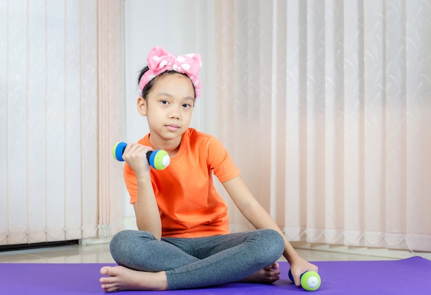 Girl doing exercises at home