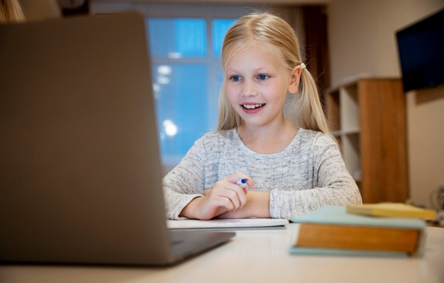 Girl doing her homework on laptop concept