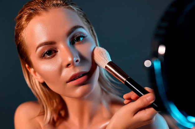 Girl doing her make up.