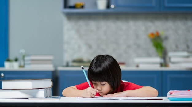 Girl doing homework, kid writing paper, education concept, back to school