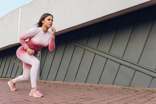 Girl doing lunges in motion