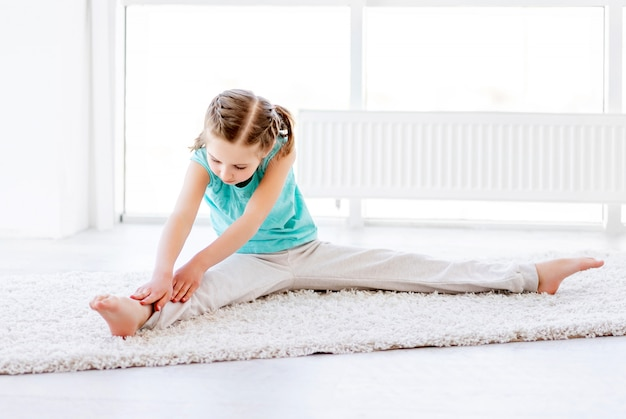 Girl doing physical exercises