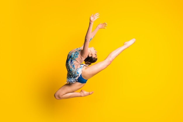 Girl doing rhythmic gymnastics jumping