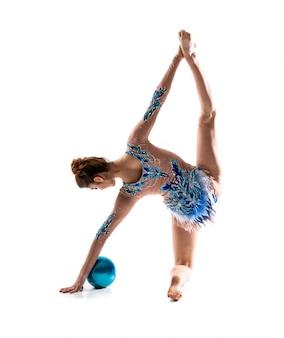 Girl doing rhythmic gymnastics with ball