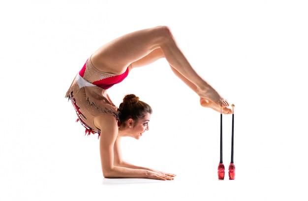 Girl doing rhythmic gymnastics with maces