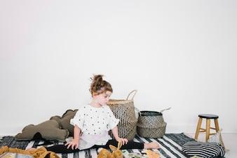 Girl doing split on rag in nursery